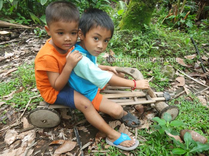 kids in ligiron, contraption like wooden bike, four wheels, Valencia, Negros Oriental