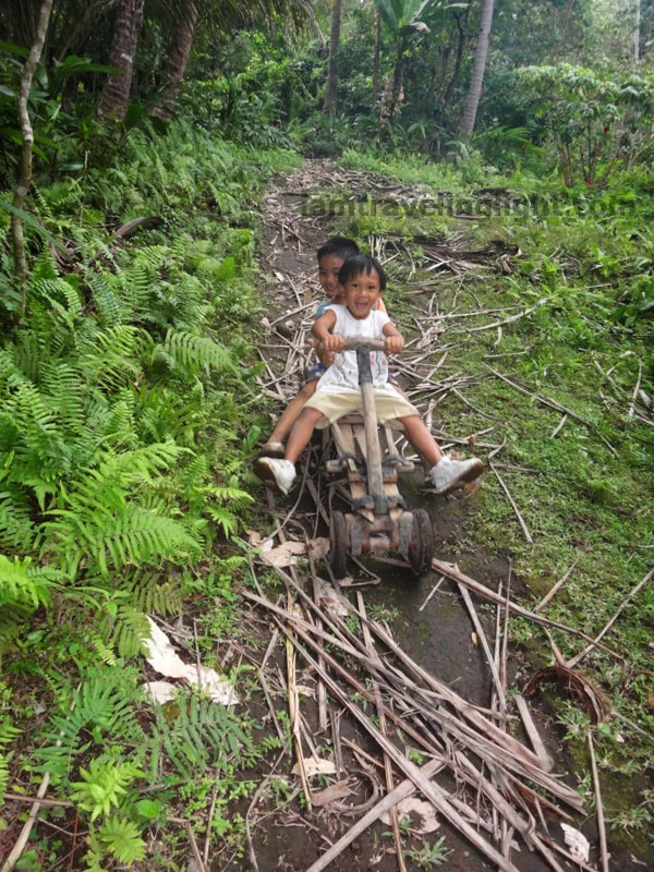 kids in ligiron riding downhill, contraption like wooden bike, four wheels, Valencia, Negros Oriental