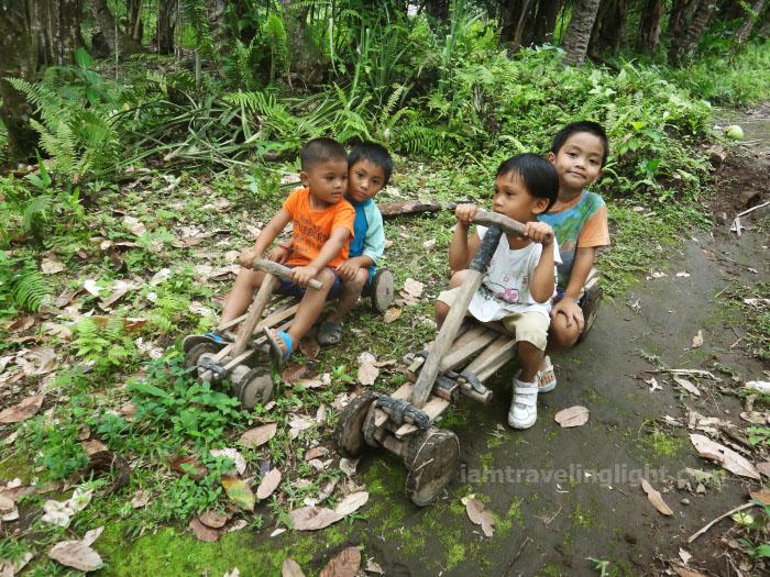 kids in ligiron, two ligirons, contraption like wooden bike, four wheels, Valencia, Negros Oriental