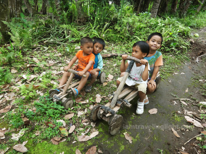 kids in ligiron, two ligirons, contraption like wooden bike, four wheels, Valencia, Negros Oriental