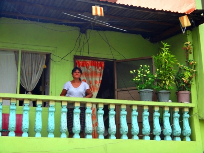 An Estero de Paco resident looks on