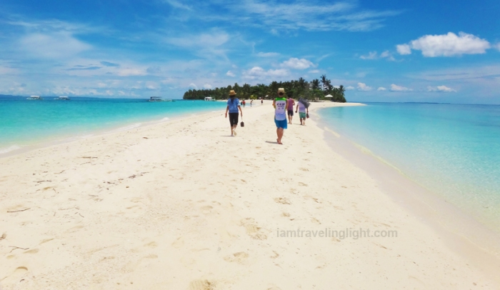 people walking Kalanggaman Island sandbar, unspoiled white beach, Palompon, Leyte, Philippines