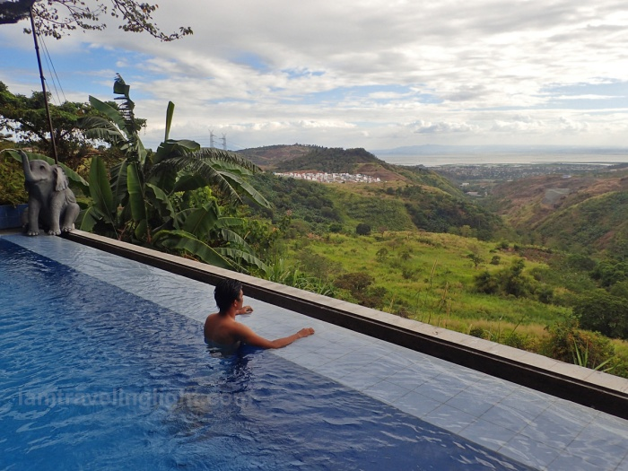 man at infinity pool, luljetta's hanging gardens and spa, antipolo, breathtaking view of rizal and metro manila.jpg