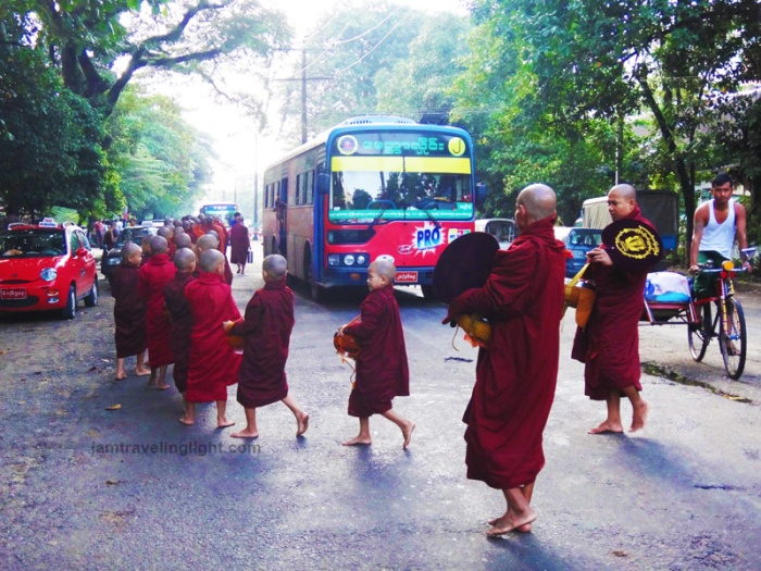 Buddhist monks crossing the street, Buddhist monks stop traffic, yangon, myanmar