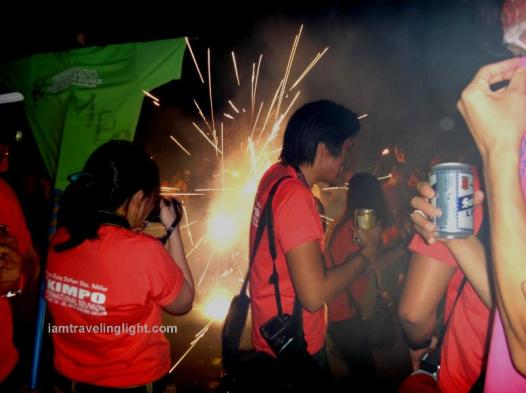 Family parade, firecrackers, drinking beer while revelry making, party, crowds, Kalibo Ati-atihan Festival 2014