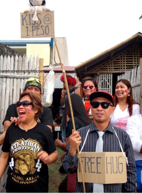 free hug, one-peso kiss, Kalibo Ati-atihan Festival 2014 merrymaking, revelry, parade