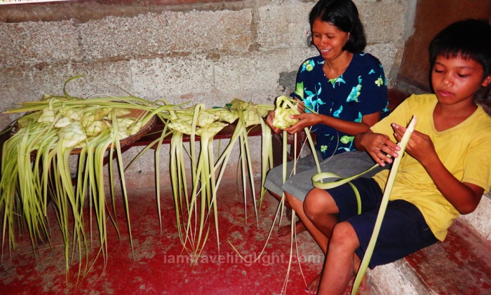 locals making puso, coconut palm leaves used to wrap rice, bohol, visayas, philippines