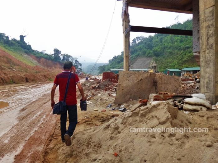 muddy roads crossing the border vietnam to laos, hanoi to vientiane bus