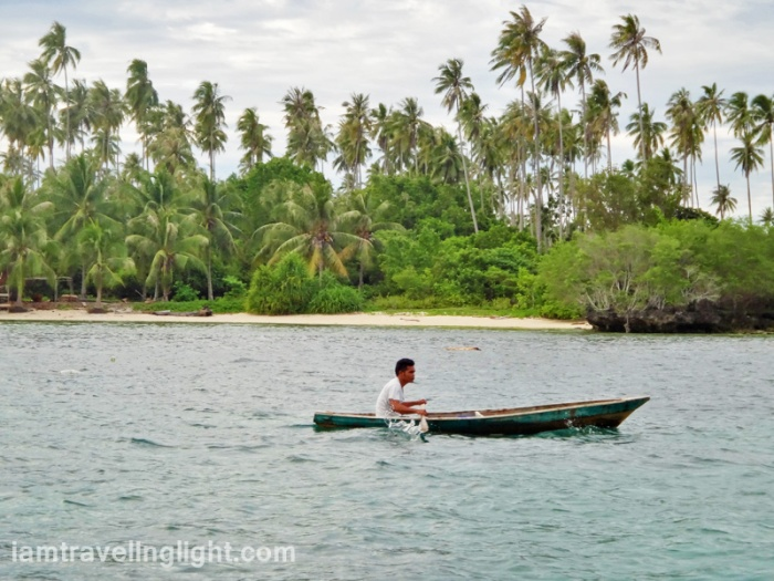 man on boat, near Tandubanak port, remote Sibutu Island, Tawi-tawi, Philippines