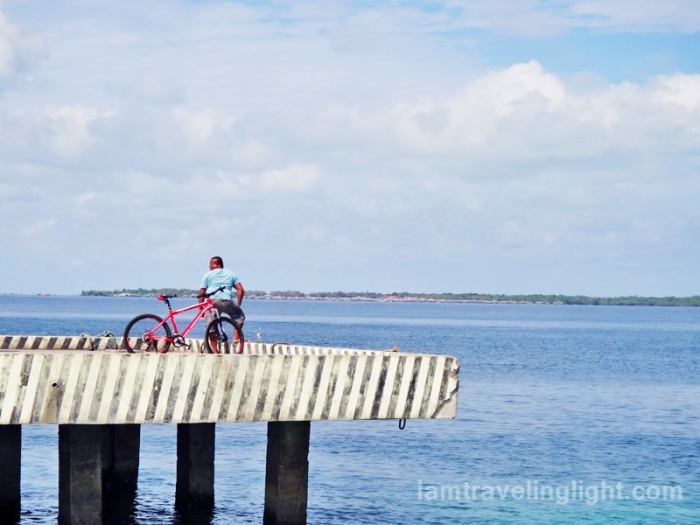 man with bike at Sibutu port, Tawi-tawi, Philippines