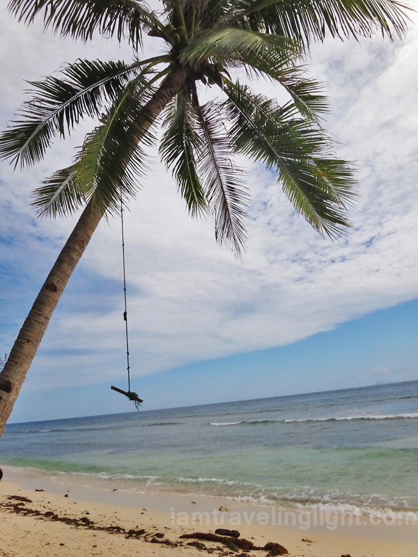 wooden swing, unspoiled white beach, remote Sibutu Island, Tawitawi, Philippines
