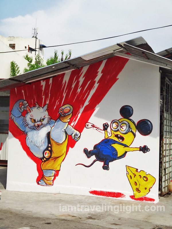 Cat fighting minion, cat street art, Penang, Malaysia