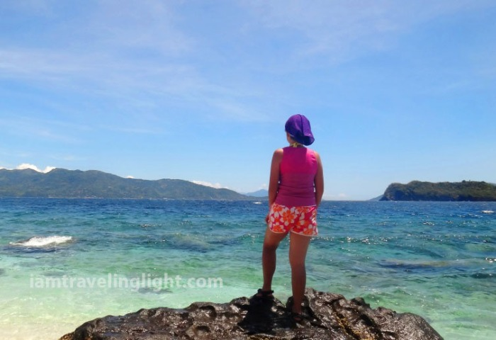 explorer-looking-to-the-horizon-sea-with-watermark