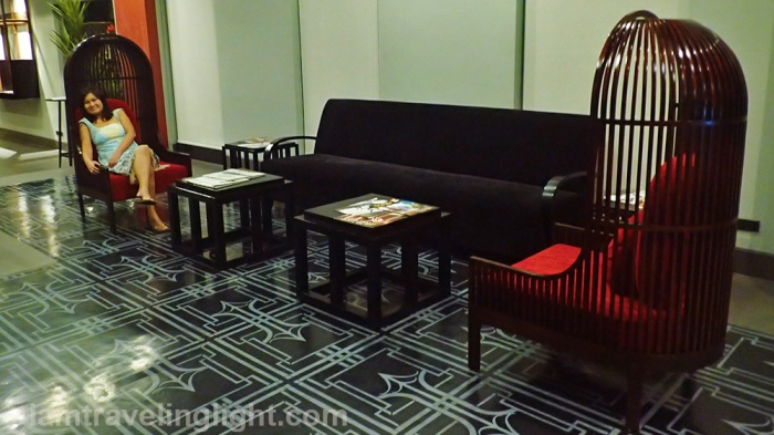 sofa nest, couch, red accent, wooden frame, lobby, relaxing, Amelie Hotel Manila, Malate.jpg