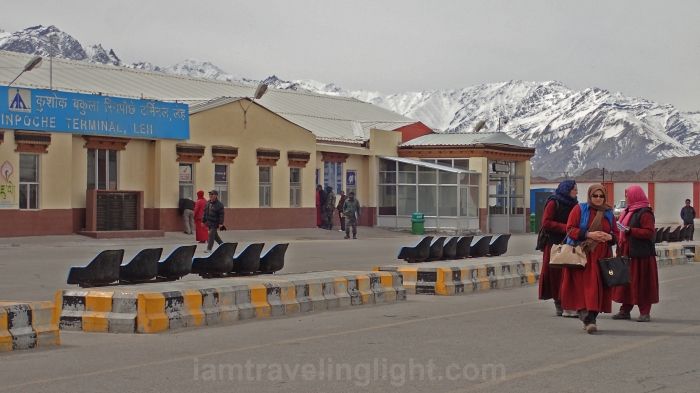 leaving the airport, ladakhi women in traditional attire, ladakh, winter, snowcapped mountains, kushok bakula rinpoche airport, leh, india.jpg