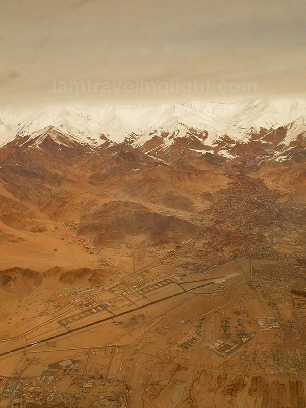 Leh town from above, Himalayas mountain range, snowcapped mountains, winter, view from the plane, flight to Leh Ladakh, Kashmir, from New Delhi, India.jpg