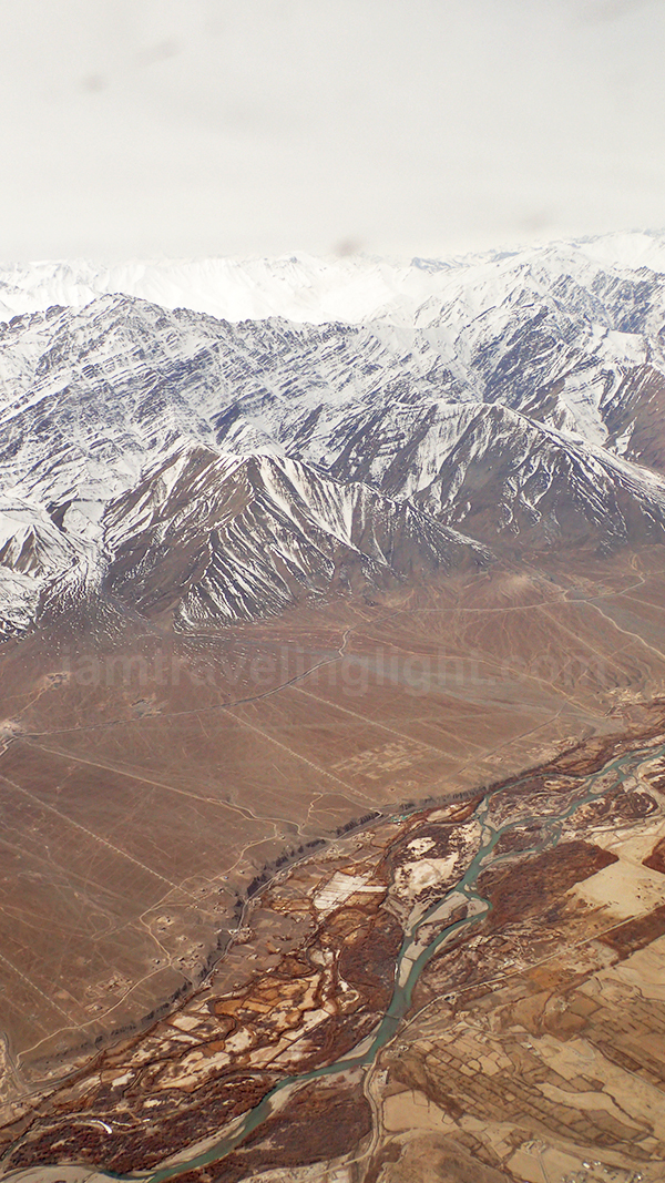 Leh town from above, river, Himalayas mountain range, snowcapped mountains, winter, view from plane, flight to Leh Ladakh, Kashmir, from New Delhi, India.jpg