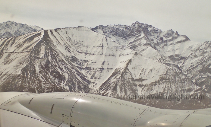 Leh town landing, Himalayas mountains at close range to plane,, snowcapped, winter, view from plane, flight to Leh Ladakh, Kashmir, from New Delhi, India.jpg