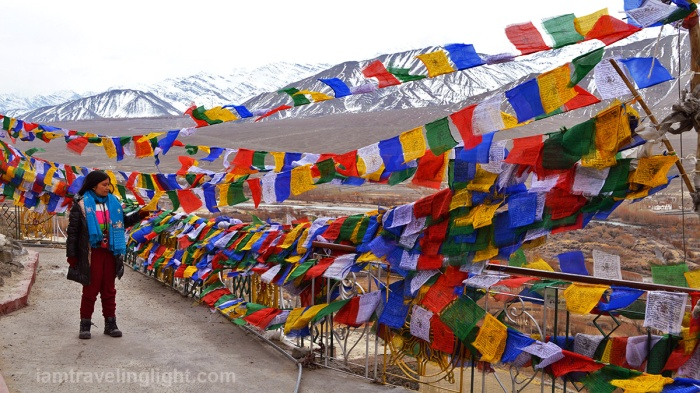 Spituk Gompa, monastery, touching colorful prayer flags, Tibetan Buddhism, view of Leh town, Ladakh, snowcapped mountains, Himalayas, landscape, India.jpg