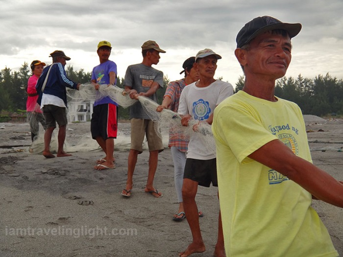 fisherfolk pulling net, catching fish, morning, surfing beach, mountain backdrop, surf, Liwliwa, San Felipe, Zambales