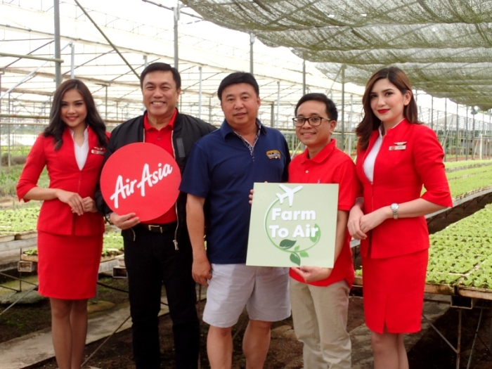AirAsia team + Salad Time farmer owner.JPG